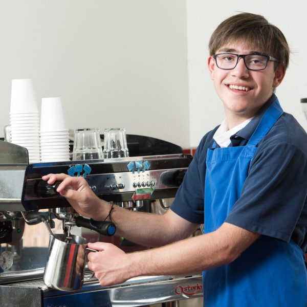 Student at barista machine